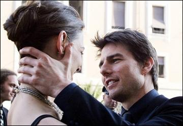 Tom Cruise restrains Katie Holmes.